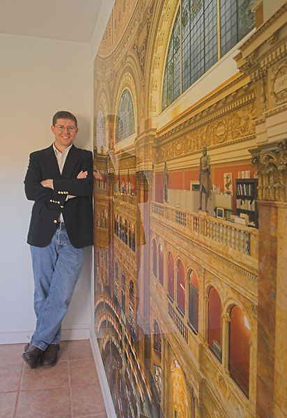 Lyons stands next to a 6x7 foot print of the Library of Congress